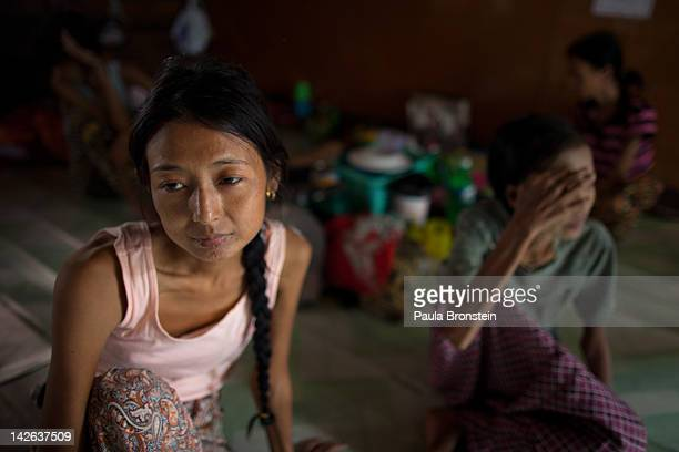 Khim Soe Wim sits in the women's room at the HIVAIDS Care and Prevention center April 5 2012 in Yangon Myanmar The shelter houses around 150 men...