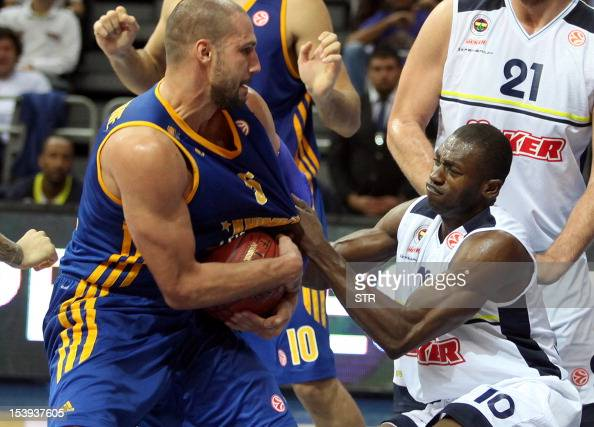 Khimki Moscow's James Augustine fights for the ball with Fenerbahce Ulker's Romain Sato during the Euroleague basketball match Fenerbahce Ulker vs...