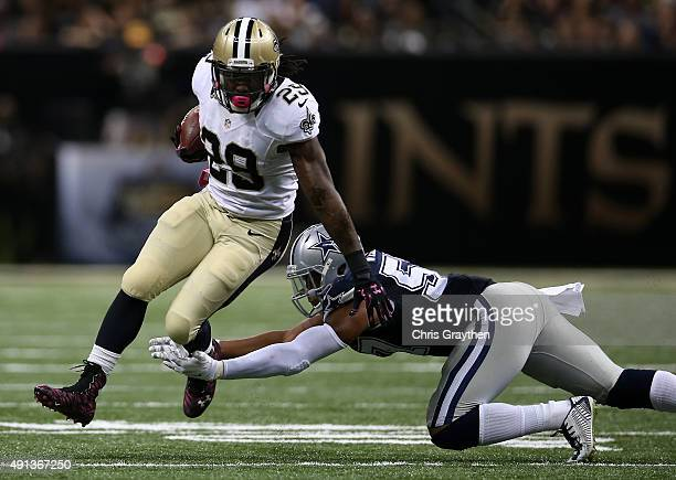 Khiry Robinson of the New Orleans Saints runs the ball as Damien Wilson of the Dallas Cowboys defends during the fourth quarter against the Dallas...