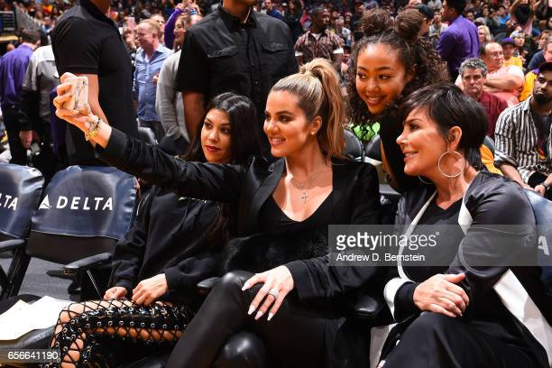 Khloé Kardashian takes a picture with Kris Jenner and Kourtney Kardashian during the game between the Los Angeles Lakers and the Cleveland Cavaliers...