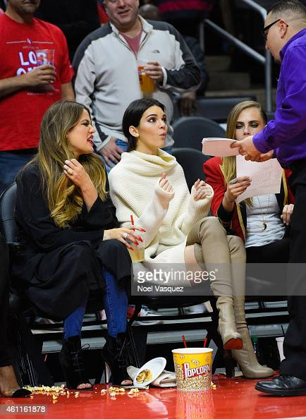 Khloe Kardashian and Kendall Jenner attend a basketball game between the Los Angeles Lakers and the Los Angeles Clippers at Staples Center on January...