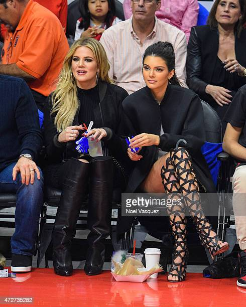 Khloe Kardashian and Kendall Jenner attend a basketball game between the Houston Rockets and The Los Angeles Clippers at Staples Center on May 8 2015...