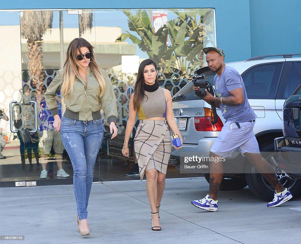 Khloe Kardashian and Kourtney Kardashian are seen on April 11, 2014 in Los Angeles, California.