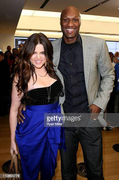 Khloe Kardashian and Lamar Odom pose during the Microsoft Store Opening at South Coast Plaza on March 24 2011 in Costa Mesa California