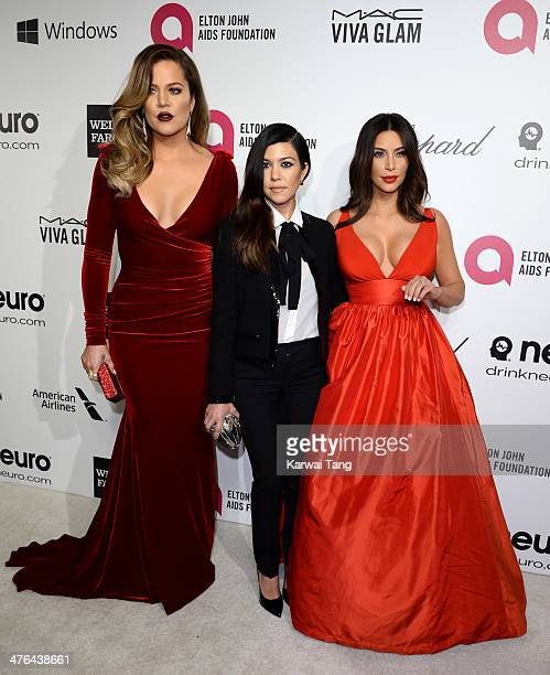 Khloe Kardashian Kourtney Kardashian and Kim Kardashian arrive for the 22nd Annual Elton John AIDS Foundation's Oscar Viewing Party held at West...