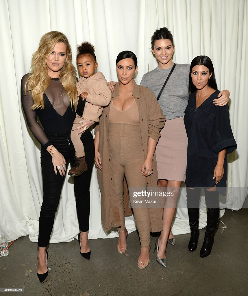 Khloe Kardashian North West Kim Kardashian West Kendall Jenner and Kourtney Kardashian attend Kanye West Yeezy Season 2 during New York Fashion Week...