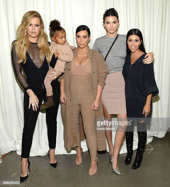 Khloe Kardashian North West Kim Kardashian West Kendall Jenner and Kourtney Kardashian attend Kanye West Yeezy Season 2 during New York Fashion Week...