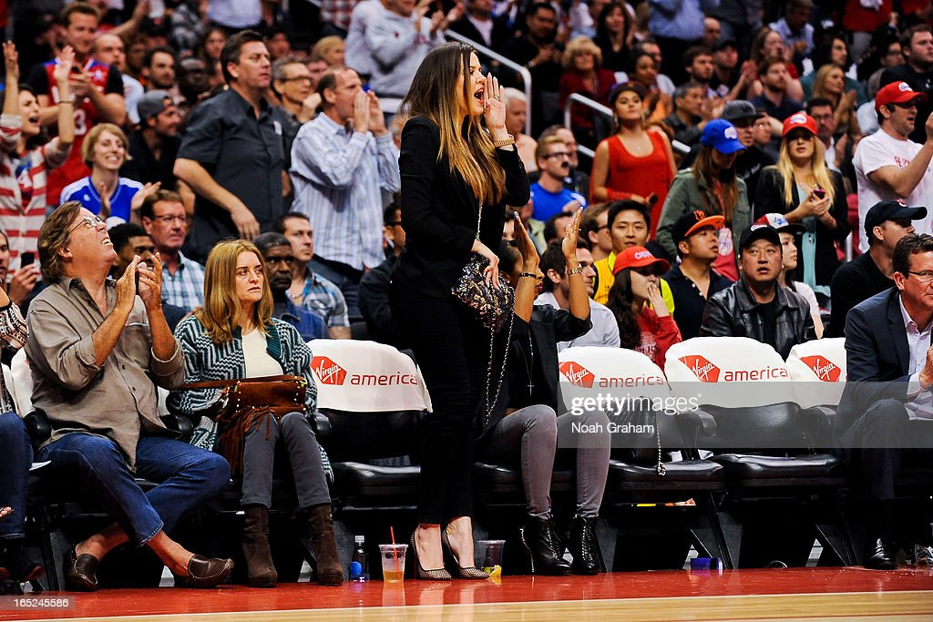 Khloe Kardashian Odom celebrates from her court-side seat during a game between the Indiana Pacers and Los Angeles Clippers at Staples Center on April 1, 2013 in Los Angeles, California.
