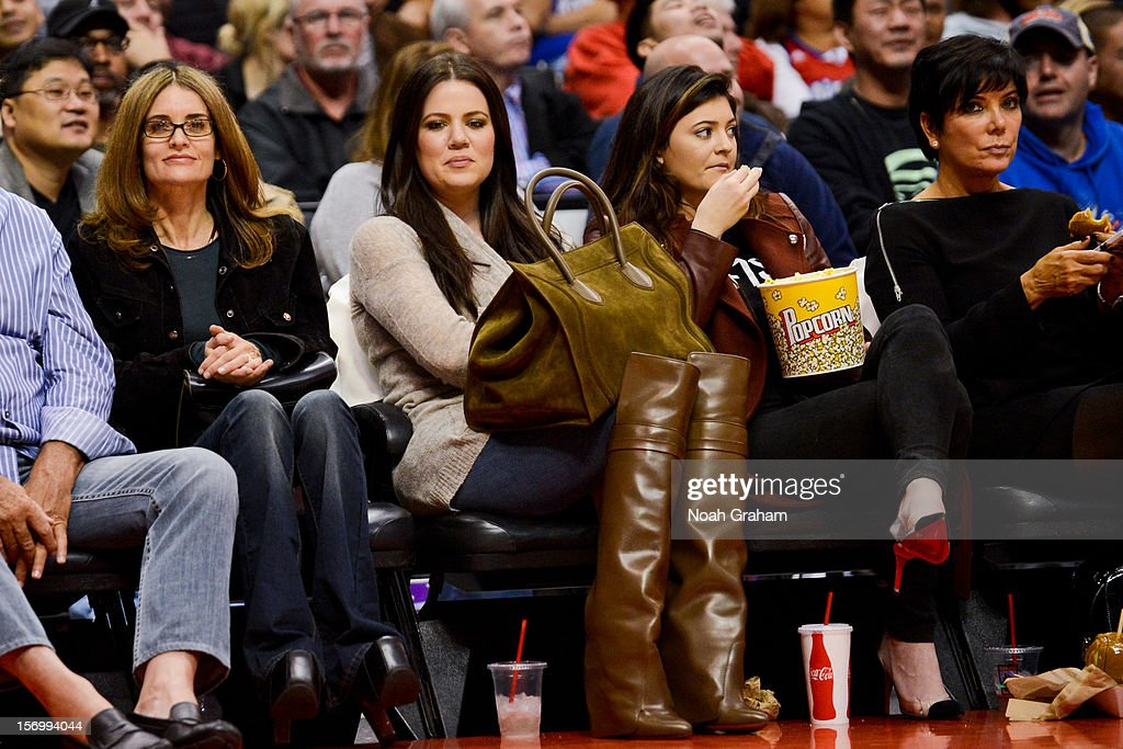 Khloe Kardashian Odom, from center left, Kylie Jenner, and Kris Jenner attend a game between the New Orleans Hornets and Los Angeles Clippers at Staples Center on November 26, 2012 in Los Angeles, California.