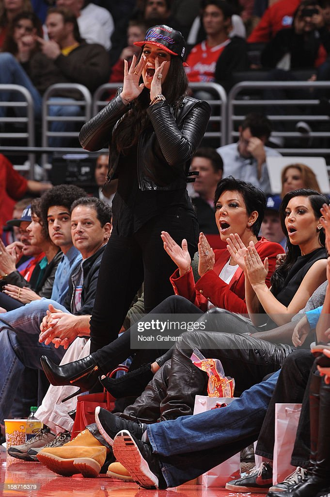 Khloe Kardashian Odom, Kris Jenner and Kim Kardashian cheer from the sideline during a Christmas Day game between the Denver Nuggets and the Los Angeles Clippers at Staples Center on December 25, 2012 in Los Angeles, California.