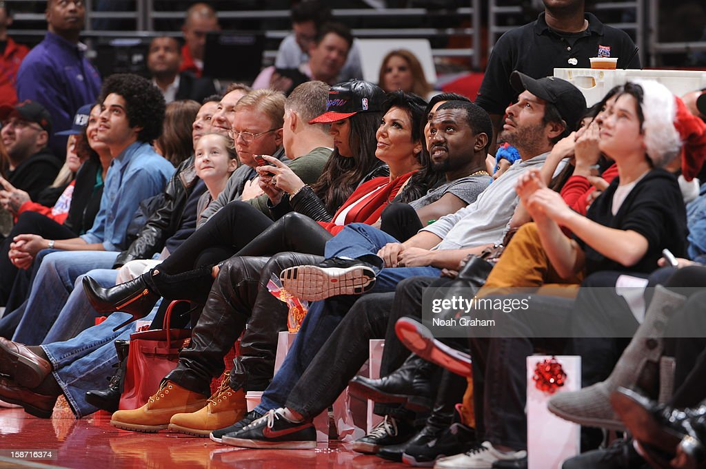 Khloe Kardashian Odom, Kris Jenner, Kim Kardashian (partially obscured) and recording artist Kanye West look on as the Denver Nuggets play the Los Angeles Clippers during a Christmas Day game at Staples Center on December 25, 2012 in Los Angeles, California.