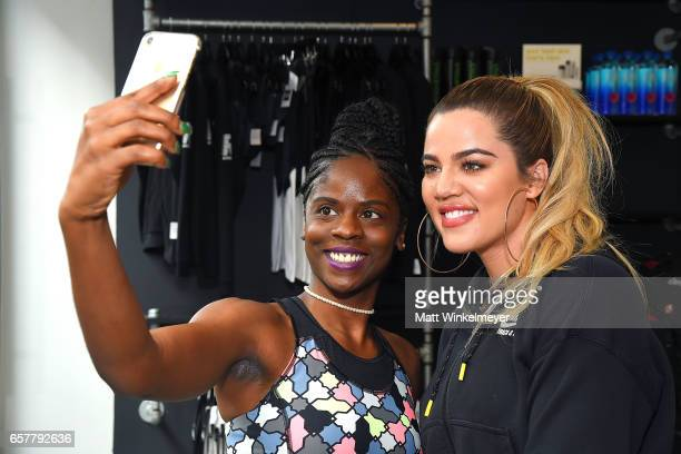 Khloe Kardashian poses for a photo with fans as she hosts a charity ride at Cycle House to benefit Children Hospital Los Angeles' Make March Matter...