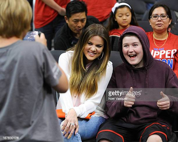 Khloe Kardashian poses with a fan at an NBA playoff game between the Memphis Grizzlies and the Los Angeles Clippers at Staples Center on April 30...