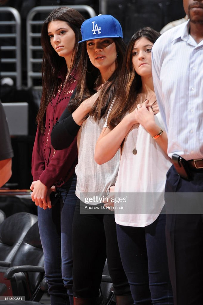 Khloe Kardashian-Odom, center, looks on between her sisters Kendall Jenner, left, and Kylie Jenner before a pre-season game between the Utah Jazz and Los Angeles Clippers at Staples Center on October 17, 2012 in Los Angeles, California.