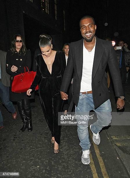 Khloe Kourtney and Kim Kardashian with Kanye West are seen leaving a restaurant on November 09 2012 in London United Kingdom