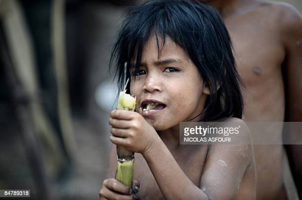 A Khmer girl eats sugar cane in Taches village on the outskirts of Phnom Penh on February 13 2009 Up to two million people were executed or died of...
