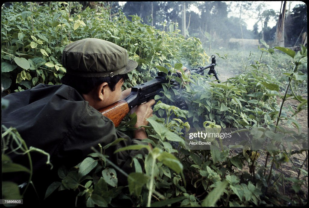 A Khmer Rouge guerrilla fires a machine gun in the Cardamom Mountains of Cambodia, 17th February 1981.