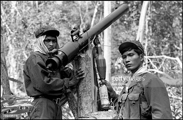 Khmer Rouge guerrillas armed with a Chinesemade 75mm recoilless rifle in the jungle of western Cambodia north of Pailin in the Cardamom Mountains...