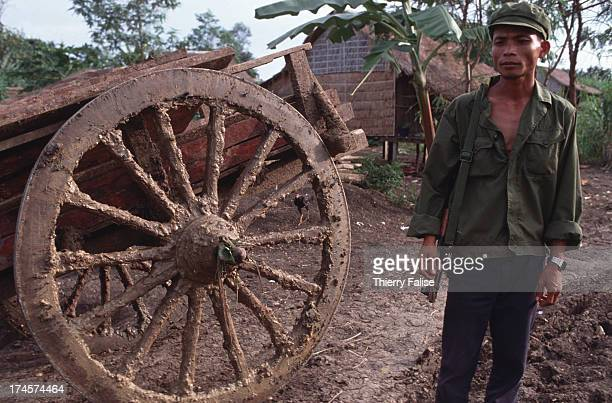 Khmer Rouge soldier in front of an ox cart in Phnom Malai