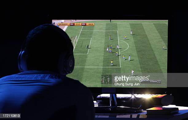 Khoie Seyed Davoud of Iran competes in the eSports FIFA 13 semi final against Chen Wei of China at Samsan World Gymnasium during day four of the 4th...