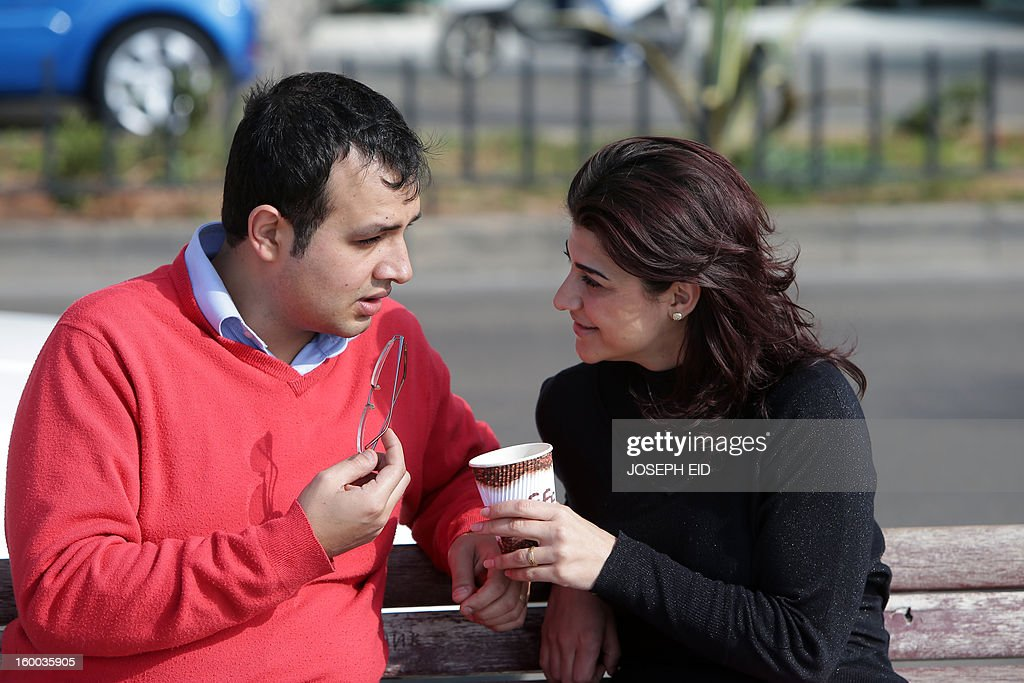 Kholoud Sukkariyeh (R) and Nidal Darwish, who got married in defiance of Lebanon's ban on civil unions, drink coffee next to Beiurt's landmark Pigeon Rock on January 25, 2013. The couple, from different Muslim sects, recited their vows in an intimate ceremony late last year at Sukkarieh's home with her brother as witness. The Lebanese authorities recognise civil weddings only if they have been registered abroad, and it has become common for mixed-faith couples to marry in nearby Cyprus.