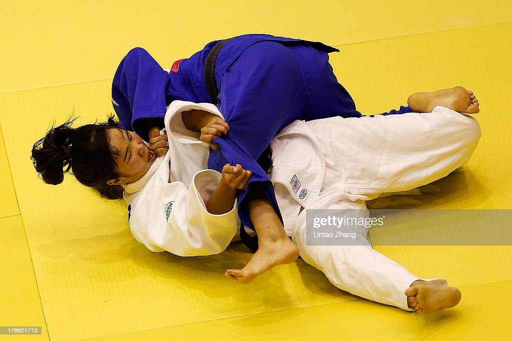 Khongorzul Battulga of Mongolia (Blue) competes against Lin Yizhou of China during the Women's 63 Kg during day three of the 2nd Asian Youth Games on August 19, 2013 in Nanjing, China.