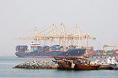 Khor Fakkan, UAE, Large cargo ships docked to load and unload goods at Khor Fakkport