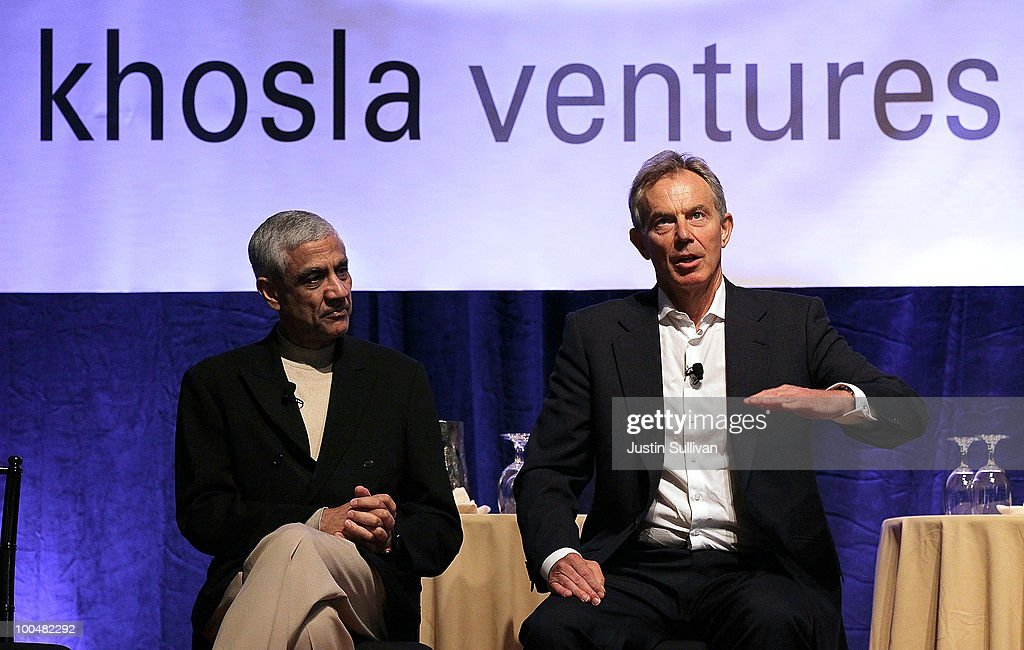 Khosla Ventures founder Vinod Khosla (L) looks on as former British Prime Minister <a gi-track='captionPersonalityLinkClicked' href=/galleries/search?phrase=Tony+Blair&family=editorial&specificpeople=118622 ng-click='$event.stopPropagation()'>Tony Blair</a> speaks during the Khosla Ventures Cleantech Discussion May 24, 2010 in Sausalito, California. Khosla Ventures founder Vinod Khosla announced today that <a gi-track='captionPersonalityLinkClicked' href=/galleries/search?phrase=Tony+Blair&family=editorial&specificpeople=118622 ng-click='$event.stopPropagation()'>Tony Blair</a> Associates will serve as special advisors to Khosla Ventures to advocate for environmental issues and use their global relationships to assist Khosla's broad portfolio of clean technology companies maximize their effectiveness in achieving their environmental goals.