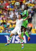 Khosro Heydari of Iran goes up for the ball with Juwon Oshaniwa of Nigeria during the 2014 FIFA World Cup Brazil Group F match between Iran and...