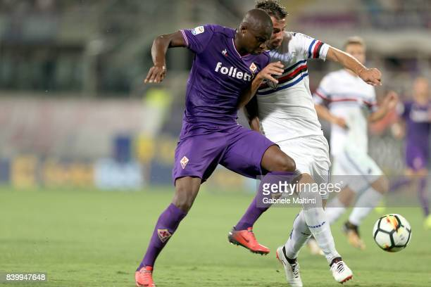 Khouma Babacar of ACF Fiorentina battles for the ball with Gian Marco Ferrari of UC Sampdoria during the Serie A match between ACF Fiorentina and UC...