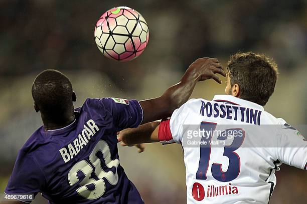 Khouma Babacar of ACF Fiorentina battles for the ball with Luca Rossettini of Bologna FC during the Serie A match between ACF Fiorentina and Bologna...