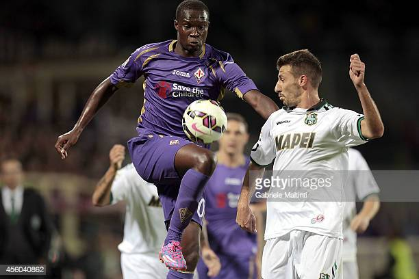 Khouma Babacar of ACF Fiorentina fights for the ball with Alessandro Longhi of US Sassuolo Calcio during the Serie A match between ACF Fiorentina and...