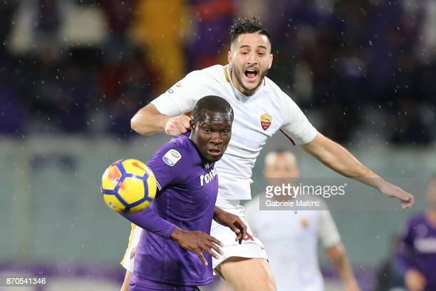 Khouma Babacar of ACF Fiorentina for the ball with Kostas Manolas of AS Roma during the Serie A match between ACF Fiorentina and AS Roma at Stadio...