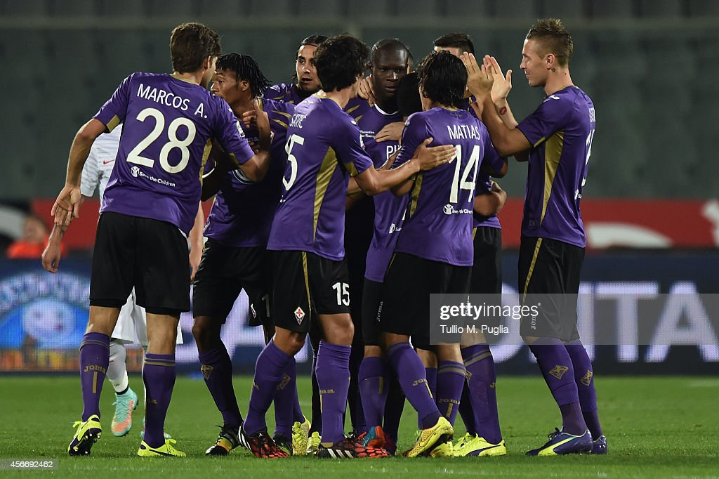Khouma Bambacar of Fiorentina celebrates with team mates after scoring the opening goal during the Serie A match between ACF Fiorentina and FC Internazionale Milano at Stadio Artemio Franchi on October 5, 2014 in Florence, Italy.