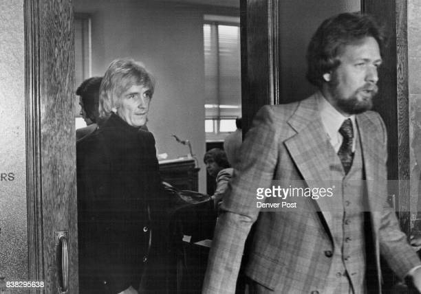 Khow Radio personality Harold 'Hal' Moore at left follows attorney Stan Marks from Denver District Courtroom after arraignment for Moore and Khow...