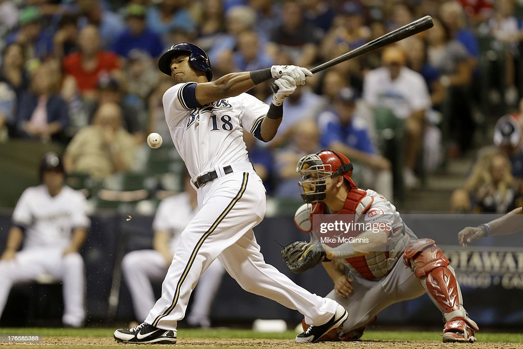 Khris Davis #18 of the Milwaukee Brewers fouls off a pitch in the bottom of the seventh inning against the Cincinnati Reds at Miller Park on August 15, 2013 in Milwaukee, Wisconsin.