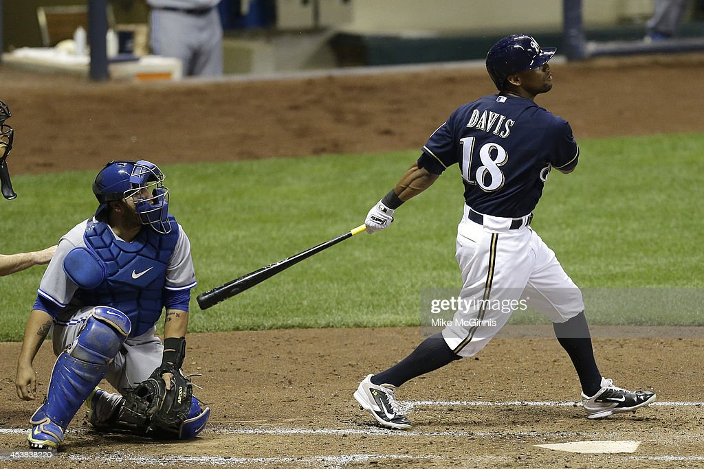 Khris Davis #18 of the Milwaukee Brewers hits a sacrifice fly to kenterfield scoring Ryan Braun in the bottom of the third inning against the Toronto Blue Jays during the Interleague game at Miller Park on August 19, 2014 in Milwaukee, Wisconsin.
