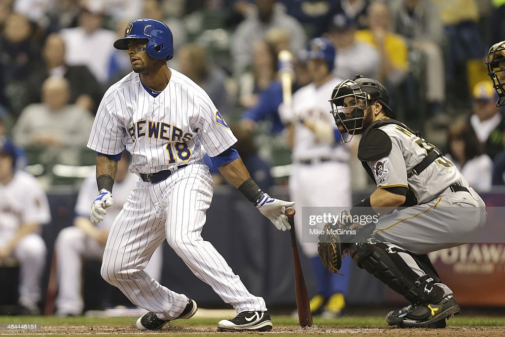 Khris Davis #18 of the Milwaukee Brewers hits a single in the bottom of the second inning against the Pittsburgh Pirates at Miller Park on April 12, 2014 in Milwaukee, Wisconsin.