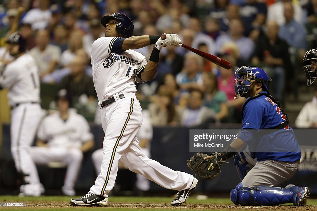 Khris Davis #18 of the Milwaukee Brewers hits a solo home run in the bottom of the fourth inning against the Chicago Cubs at Miller Park on September 18, 2013 in Milwaukee, Wisconsin.
