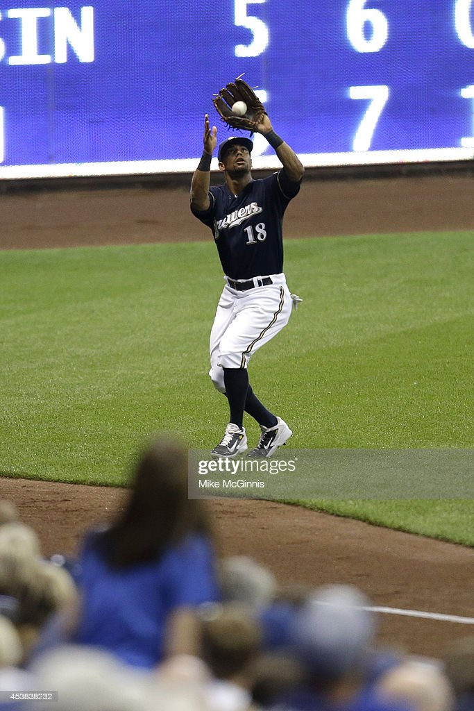 Khris Davis #18 of the Milwaukee Brewers makes the catch in left field to retire Melky Cabrera of the Toronto Blue Jays in the top of the first inning during the Interleague game at Miller Park on August 19, 2014 in Milwaukee, Wisconsin.