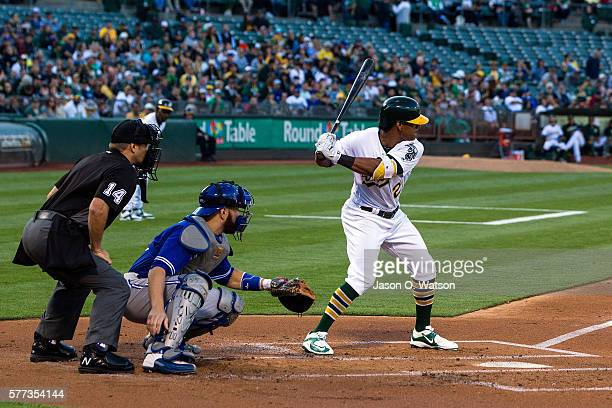 Khris Davis of the Oakland Athletics at bat in front of Russell Martin of the Toronto Blue Jays and umpire Mark Wegner during the first inning at the...