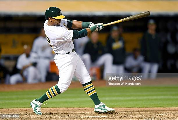 Khris Davis of the Oakland Athletics bats against the Kansas City Royals at Oco Coliseum on April 15 2016 in Oakland California All players are...