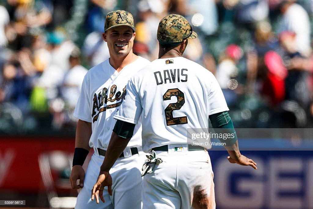 <a gi-track='captionPersonalityLinkClicked' href=/galleries/search?phrase=Khris+Davis+-+Baseball+Player&family=editorial&specificpeople=7890487 ng-click='$event.stopPropagation()'>Khris Davis</a> #2 of the Oakland Athletics celebrates with <a gi-track='captionPersonalityLinkClicked' href=/galleries/search?phrase=Josh+Phegley&family=editorial&specificpeople=6796472 ng-click='$event.stopPropagation()'>Josh Phegley</a> #19 after the game against the Minnesota Twins at the Oakland Coliseum on May 30, 2016 in Oakland, California. The Oakland Athletics defeated the Minnesota Twins 3-2.