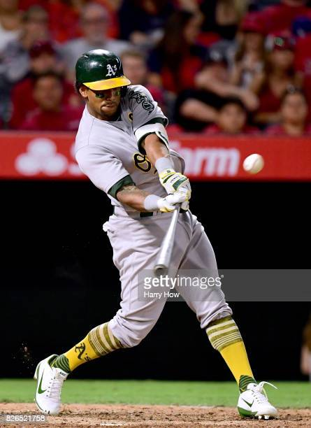 Khris Davis of the Oakland Athletics hits a two run double to take a 52 lead over the Los Angeles Angels during the fifth inning at Angel Stadium of...