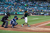 Khris Davis of the Oakland Athletics hits an RBI single against the Tampa Bay Rays during the first inning at the Oakland Coliseum on July 23 2016 in...