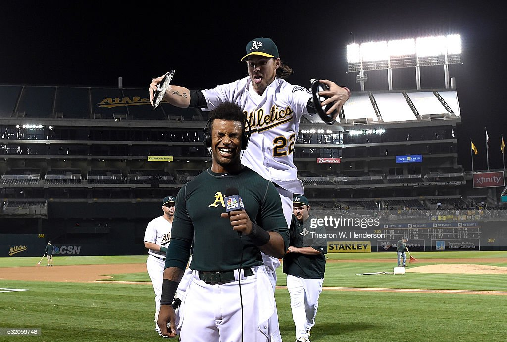 <a gi-track='captionPersonalityLinkClicked' href=/galleries/search?phrase=Khris+Davis+-+Baseball+Player&family=editorial&specificpeople=7890487 ng-click='$event.stopPropagation()'>Khris Davis</a> #2 of the Oakland Athletics is hit with cream pies by <a gi-track='captionPersonalityLinkClicked' href=/galleries/search?phrase=Josh+Reddick&family=editorial&specificpeople=5746348 ng-click='$event.stopPropagation()'>Josh Reddick</a> #22 after Davis hit a walk off grand slam home run against the Texas Rangers in the bottom of the ninth inning at O.co Coliseum on May 17, 2016 in Oakland, California. The Athletics won the game 8-5.