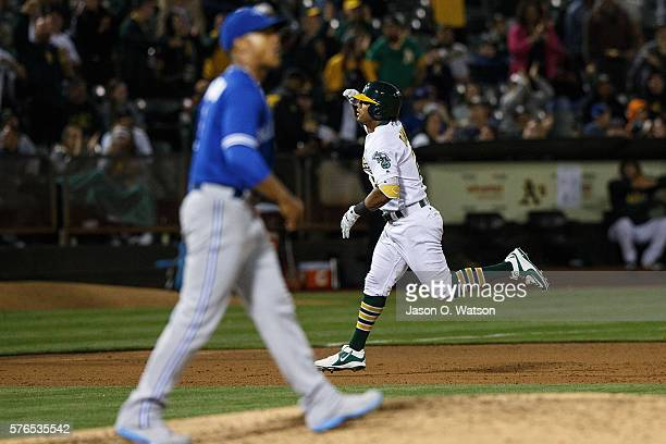 Khris Davis of the Oakland Athletics rounds the bases after hitting a two run home run off of Marcus Stroman of the Toronto Blue Jays during the...