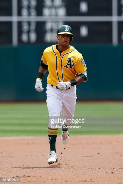 Khris Davis of the Oakland Athletics rounds the bases after hitting a tworun home run in the first inning against the Miami Marlins at Oakland...