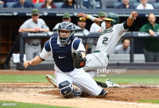Khris Davis of the Oakland Athletics scores on a hit by Ryon Healy as Gary Sanchez of the New York Yankees cannot make the tag in the sixth inning...