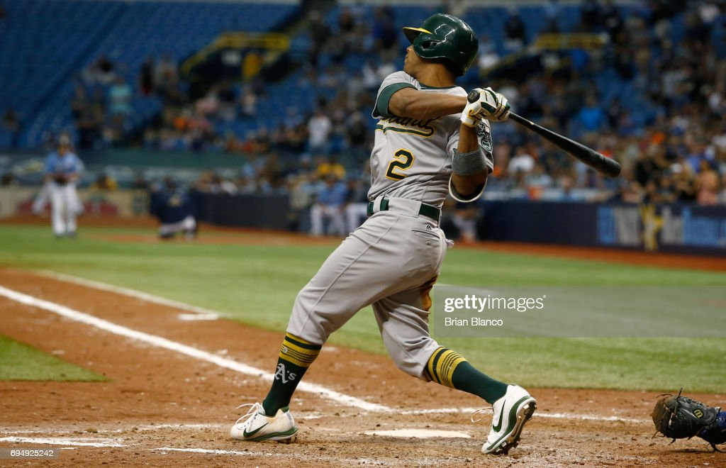 Khris Davis #2 of the Oakland Athletics strikes out swinging with the bases loaded to pitcher Alex Colome of the Tampa Bay Rays to end the top of the ninth inning of a game on June 11, 2017 at Tropicana Field in St. Petersburg, Florida.